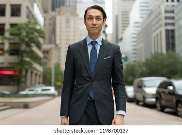 Asian businessman in city walking street