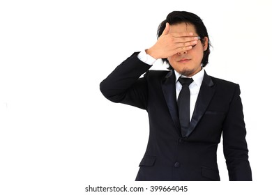 The Asian businessman closed his eyes with his hand.