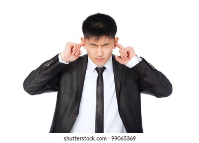 asian businessman cover ears with fingers hands, concept of frustrated young business man stressed, depressed, wear elegant suit and tie isolated over white background