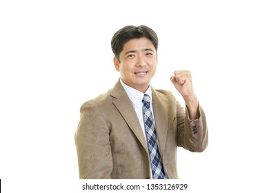 Asian businessman enjoying success.