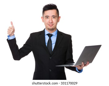 Asian Businessman hold with notebook computer and thumb up gesture