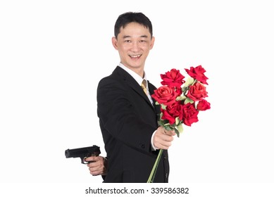 Asian businessman holding a gun and roses, The social mask, Every social has to wear a mask together. Don't believe what you see.