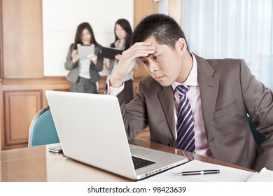 Asian businessman looks so depressed in the office