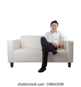 Asian businessman with phone on sofa