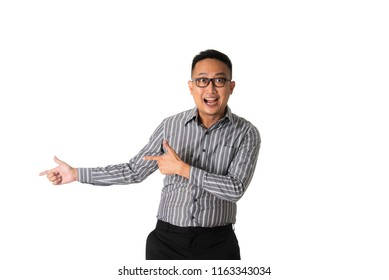 asian businessman pointed at somewhere happy and shocked
