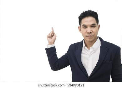 Asian businessman pointing away on white background,copy space