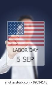 Asian businessman pushing Labor day.
