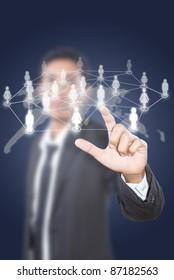 Asian businessman pushing people social network.
