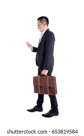 Asian businessman reading message on smart phone