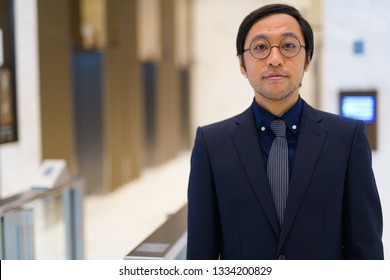 Asian businessman in the reception hall of the office building