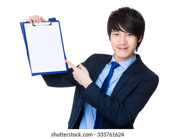Asian Businessman show with the blank page of clipboard