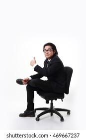 The Asian businessman sitting in the white background