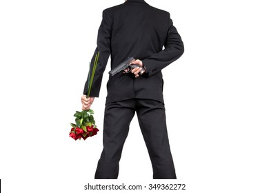 Asian Businessman Standing with Holding a Bouquet of Rose Flowers and Hiding Gun behind his back , isolated on white