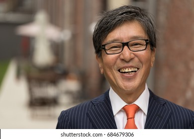Asian businessman in suit smile happy face portrait