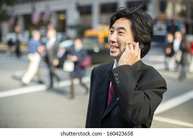 Asian businessman talking on cellphone in New York City