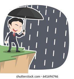 asian businessman with umbrella standing near cliff edge