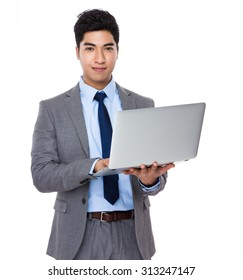 Asian businessman use of the notebook computer