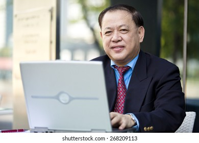 Asian businessman using laptop
