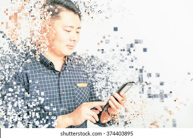asian businessman using mobile phone or tablet pc at white background for any text. Art effect of pixelated decomposition. Business, wireless technology, internet, payments, mobile banking
