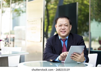 Asian businessman using tablet