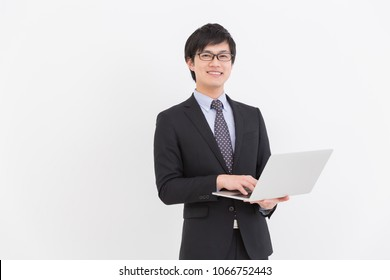 Asian businessman who uses laptop computer,