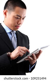Asian businessman working on digital tablet on the white background