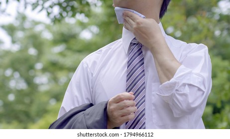 Asian businessman working outside in summer
