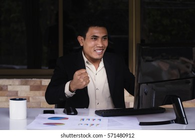 Asian businessman working seriously in the office with computer on the table