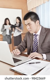 Asian businessman working seriously in the office