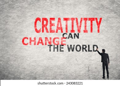 Asian businessman write text on wall, Creativity Can Change The World