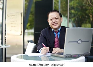 Asian businessman writing business proposal