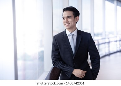 Asian Businessman young so felling happiness  in company