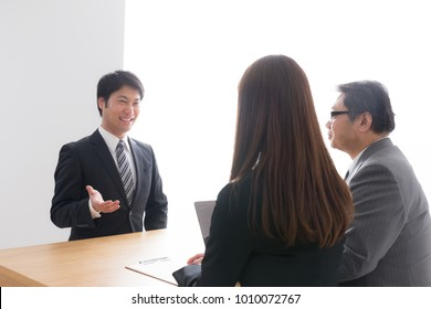 asian businessmen and businesswoman
