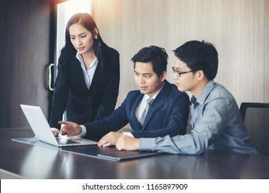 Asian businessmen and group using notebook for business partners discussing documents and ideas at meeting and business women smiling happy for working