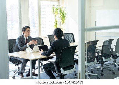 asian businessmen meeting in office