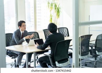 asian businessmen meeting in office