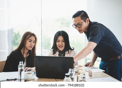 Asian businesspeople discussing and brainstorm about their projects together in meeting room. Business startup teamwork concept