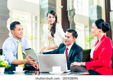 Asian businesspeople having a meeting