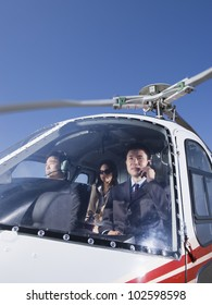 Asian businesspeople in helicopter