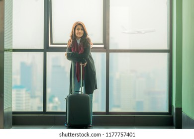 Asian businesswoman at the airport ready for traveling.