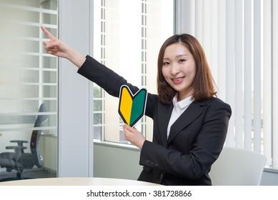 asian businesswoman with beginner mark