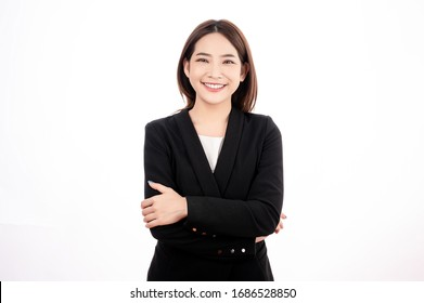 Asian businesswoman with black suit pretent crossed pose in white isolated background. Smart, confident, business, presenter concept.