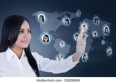 Asian businesswoman clicking on social networking map