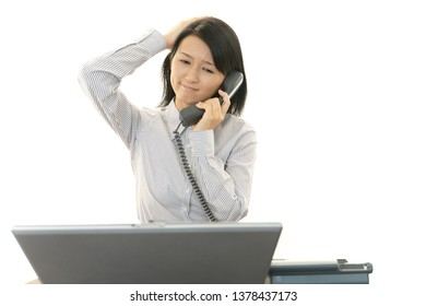 Asian businesswoman is feeling tired and stressed.