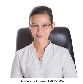 Asian businesswoman with glasses sitting on a chair