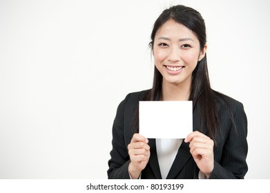 asian businesswoman holding a blank white card