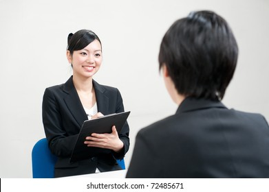 asian businesswoman interviewing