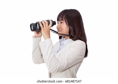 Asian businesswoman looking through field glasses on a white background. Expecting for the future.