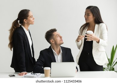 Asian businesswoman offering creative idea, explaining new business approach to millennial executive team listening working in office, diverse colleagues discussing and planning teamwork together