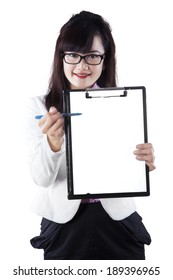 Asian businesswoman pointing at copy space on empty clipboard